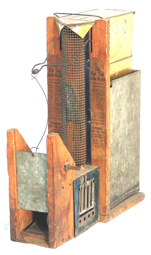 Automatic Trap Co. advertised this device as 'The Best Trap in the World.' Made of wood, tin and wire, the trap stands 11 inches high. Image courtesy of LiveAuctioneers and Richard Opfer Auctioneering Inc.