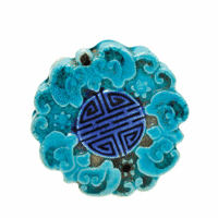This piece of turquoise-glazed pottery, 2 inches in diameter, is covered with scrolls arranged around a seal. It is a scroll water dropper sought as a collectible today. Cincinnati Art Galleries auctioned it in 2009 for $130. Photo courtesy of Mark Mussio, The Auctions at Rookwood.