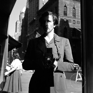 Vivian Maier shot this self-portrait reflected in a New York storefront window with her ever-present Rolleiflex twin lens reflex. The photograph is dated Oct. 18, 1953. From the Archive of Maloof Collection Ltd. Courtesy of Chicago Cultural Center.