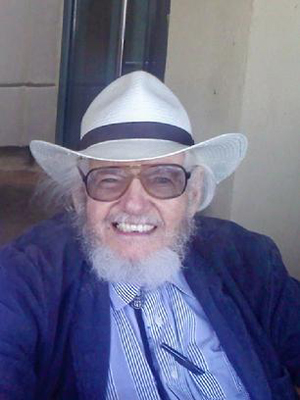 Animation artist Tom Ray wearing his trademark bolo tie and cowboy hat. Image courtesy of Tomstone Animation Art Gallery and Studios.