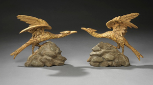A charming pair of George III Rococo giltwood and carved ho-ho birds, circa 1760, in the manner of Thomas Chippendale, standing on rocaille bases, on the stand of Charles Mackinnon at the BADA Fair opening in London on March 23. Image courtesy Charles Mackinnon and BADA.