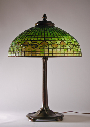 Tiffany 20-inch Acorn leaded-glass lamp. Myers Auction Gallery image.