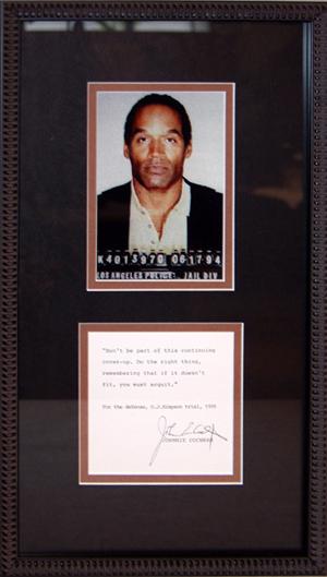 O.J. Simpson's 1994 mug shot, framed with an autograph of his attorney Johnny Cochran. Image courtesy of LiveAuctioneers and DuMouchelles.