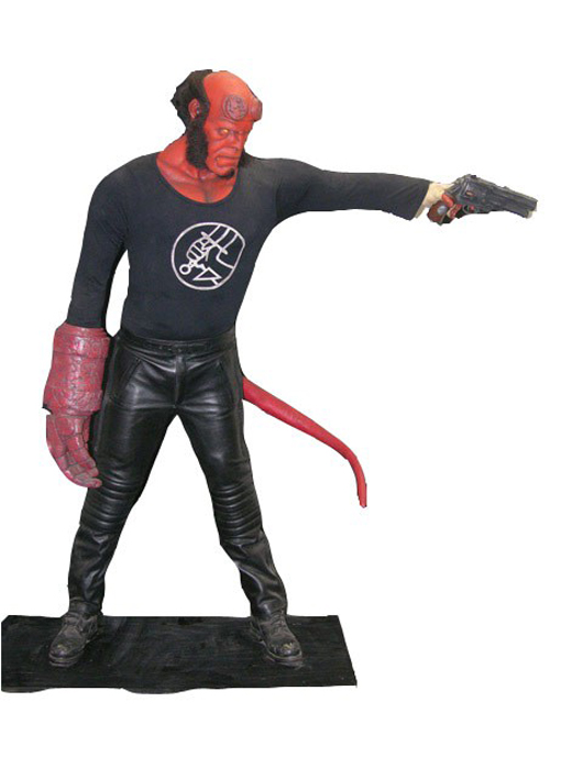 'Hellboy' (2004) costume on stand-up life-size form. His 'hand of doom,' head and gun are high-end replicas made from the original molds. Also included are five rare teaser posters with Hellboy creator Mike Mignola artwork. Estimate: $500-$1,000. Image courtesy of Premiere Props.