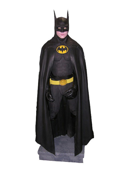 'Batman Returns' (1992) – Batman (Michael Keaton) screen-worn original hero bat suit from the film directed by Tim Burton. Boots are not original, however, were made from the original molds. Estimate: $42,000-$45,000. Image courtesy of Premiere Props.