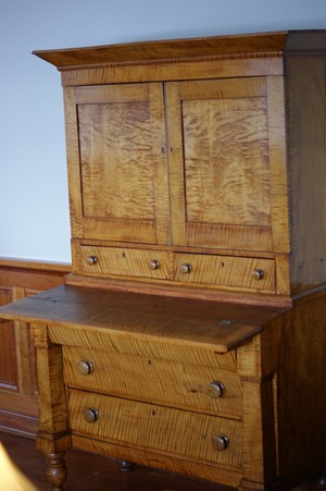 The profusion of tiger maple in this desk is an indication it was made for a special customer – a future U.S. president. Image by Ryan E. Hulse, courtesy of Franklin Pierce University.