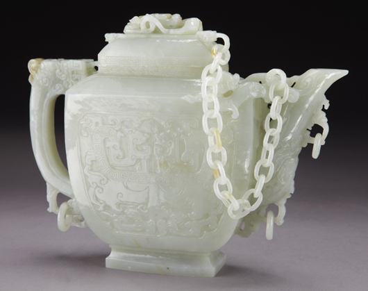 Chinese carved white jade teapot, the lid attached to the body by a jade chain. 6.75 inches high x 9 inches wide, circa early 20th century. Price realized: $30,625. Image courtesy of Dallas Aucton Gallery.