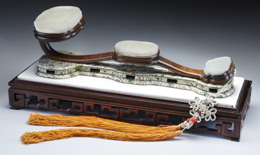 Chinese Qing jade inlaid carved ruyi scepter in its original rosewood box, carved to depict eight lucky symbols, 17 inches long, circa 19th century. Price realized: $24,500. Image courtesy of Dallas Aucton Gallery.