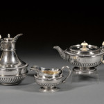 Three-piece George III silver tea set, London, 1810, Paul Storr, maker, includes teapot, urn-form hot water pot and creamer. Estimate $4,000-$6,000. Image courtesy of Skinner Inc.