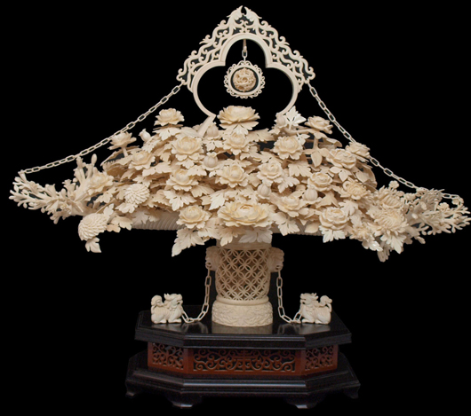 Chinese carved ivory flower basket on elaborate stand, 27 inches high x 40 inches wide x 19 inches deep. Estimate: $3,000-$5,000. Austin Auction Gallery image.
