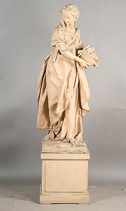 Antique French terra-cotta garden figure of a beautiful young girl in draped gown with flaming torch, circa 1860. Estimate: $4,000-$6,000. Image courtesy of Kamelot Auctions.