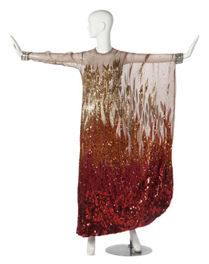 Nolan Miller silk chiffon and sequin flame evening gown worn in a performance of 'Love on the Rocks' with Tom Jones. No label. Property from the Collection of Gladys Knight, Las Vegas, Nevada. Estimate: $400-$600. Image courtesy Leslie Hindman Auctioneers.