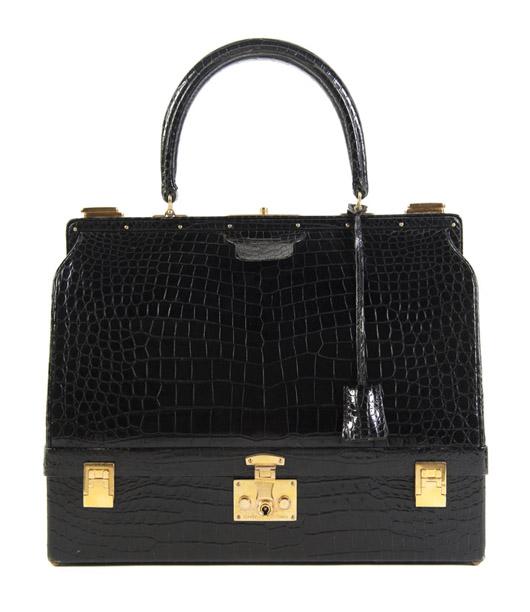 Hermès black alligator sac mallette bag, 1960s, with gold hardware, key sheath, red velvet lining, 14 inches x 9 inches x 5 inches. Stamped: Hermès. Estimate: $10,000-$15,000. Image courtesy Leslie Hindman Auctioneers.