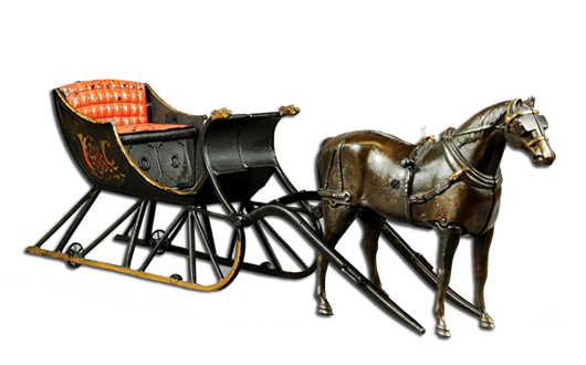 Ives cast-iron cutter sleigh with articulated walking horse, $86,250. Bertoia Auctions image.