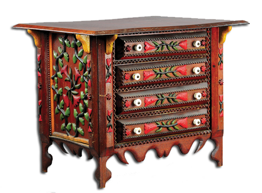 Child's tramp art chest with pull-out drawers, elaborate carving, $10,925. Bertoia Auctions image.