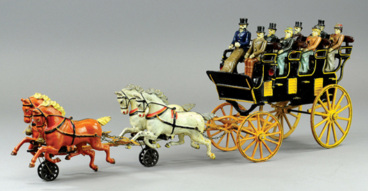Pratt & Letchworth cast-iron four-seat brake with passengers and four-horse team, $48,875. Bertoia Auctions image.