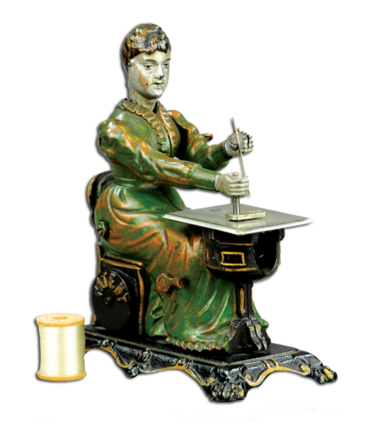 Cast-iron woman at sewing machine, attributed to Sandt, one of few known, $23,000. Bertoia Auctions image.