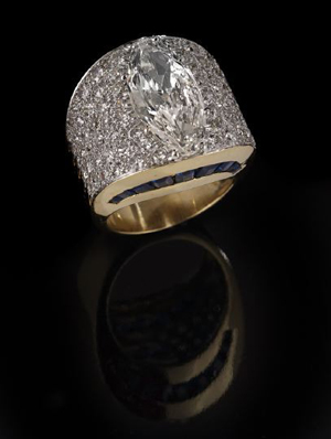 18K yellow gold, diamond and sapphire ring by David Web with central 6.67-carat marquise-cut diamond, estimate $50,000-$80,000. New Orleans Auction Galleries image.