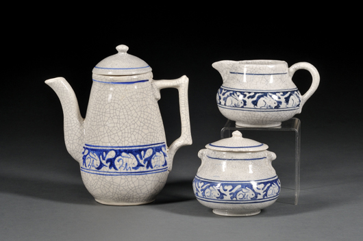 This coffee pot, creamer, and sugar bowl are among the many pieces of Dedham pottery to be offered in the June 25 Skinner sale. The three items also show the variations in hue of the cobalt blue border found among rabbit-bordered dishes. Image courtesy Skinner Inc.