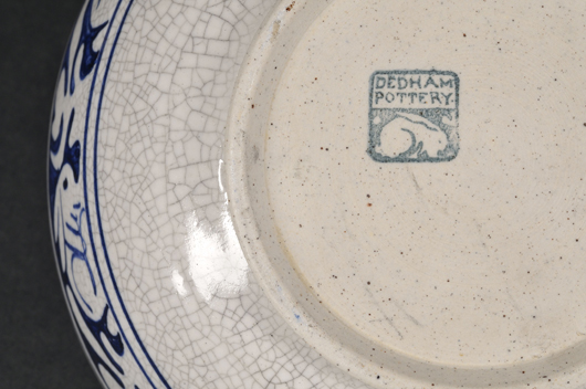 The distinctive Dedham rabbit from the popular dinnerware border was also part of the stamped mark that identified the pottery's products. Note also the characteristic crackle glaze found on all pieces in the line. Image courtesy Skinner Inc.