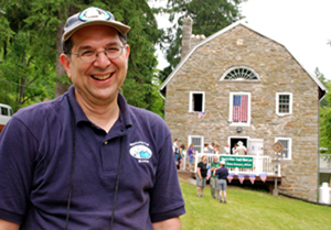 Larry Luxenberg, president of the Appalachian Trail Museum Society, greets visitors outside the 200-year-old gristmill that was renovated to house the group's museum. Image courtesy of the Appalachian Trail Museum Society.