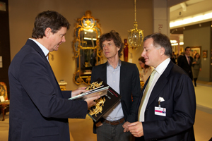 Sir Mick Jagger in conversation with friends at the inaugural Masterpiece Fine Art & Antiques Fair in London in June 2010. Image courtesy of Masterpiece Fair.