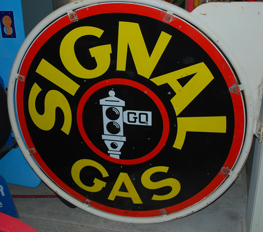 Signal Gas double-sided porcelain sign with holder, black stoplight graphic, rated 8, $4,600. Matthews Auctions image.