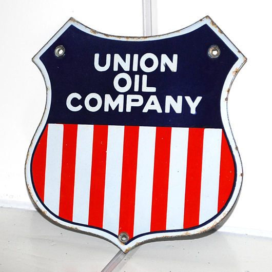 Union Oil Company single-sided porcelain die-cut sign with tri-color logo, rated 9+, $2,300. Matthews Auctions image.