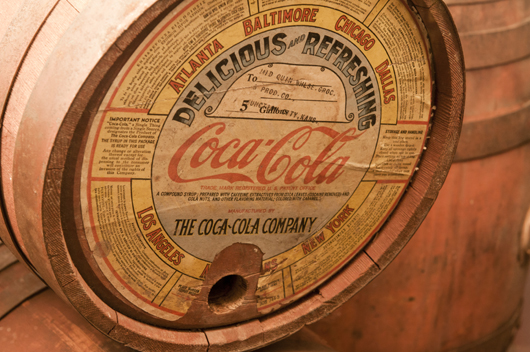 The paper label indicates this 1920s wooden barrel of Coca-Cola syrup was delivered to a wholesale grocer in Junction City, Kans. Image courtesy of the Schmidt Museum of Coca-Cola Collectibles.