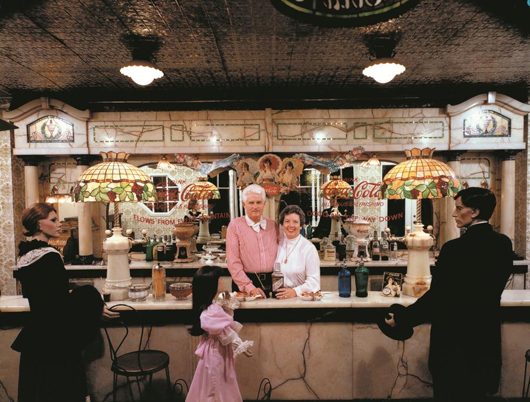Bill and Jan Schmidt posed for this photo in 1983. The soda fountain, which was part of the 1893 World's Fair in Chicago, will be sold at the first auction. Image courtesy of the Schmidt Museum of Coca-Cola Collectibles.