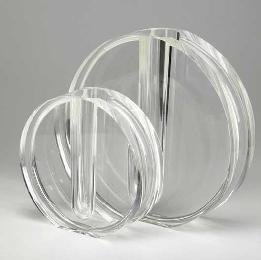 These Lucite circular form candlesticks echo the 1970s. The larger one is 14 inches tall. Image courtesy of LiveAuctioneers Archive and Rago Arts & Auction Center.