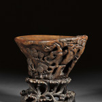 Rhinoceros horn libation cup, China, 18th century, 3 3/8 inches high, 6 3/8 inches long. Estimate: $5,000-$7,000. Image courtesy of Skinner Inc.