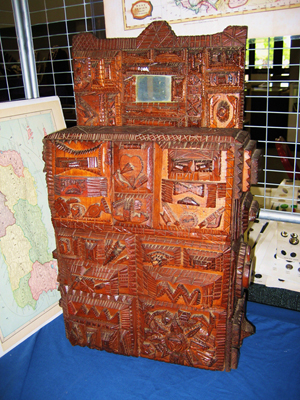 This elaborately carved wall box with drawers, circa 1930s, 18 inches tall by 12 inches wide, was offered by Florida dealer Larry Roberts. Image courtesy of the West Palm Beach Antiques Festival.