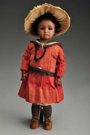 Rare and beautiful Simon & Halbig black character doll, 15 inches, in original sailor dress, est. $6,000-$8,000. Morphy Auctions image.