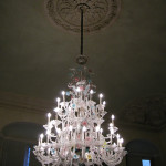 An ornate Murano glass chandelier symbolizes the title of this summer's Venice Biennale, 'IllumiNations.' Image courtesy of Wikimedia Commons.