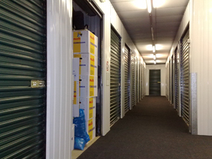 Orderly stacked and taped boxes in a self storage unit are a sign of valuable contents, while unmarked plastic are not. This file is licensed under the Creative Commons Attribution-Share Alike 3.0 Unported license.