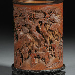 Bamboo brush pot, China, 18th century, carved with Immortals in a mountainous landscape, ht. 6 inches. Sold for $539,500. Image courtesy of LiveAuctioneers.com Archive and Skinner Inc.