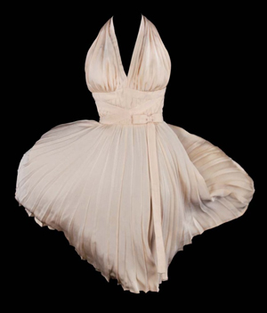 """Ivory pleated """"Subway"""" dress by Travilla, worn by Marilyn Monroe in the 1955 film The Seven Year Itch, sold by Profiles in History on June 18, 2011 for $5,658,000, inclusive of 23% buyer's premium. Image courtesy of LiveAuctioneers.com Archive and Profiles in History."""