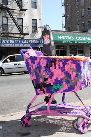 Even before entering the store, a yarn-covered shopping cart by crochet-enthusiast Olek welcomes visitors. Photo by Kelsey Savage Hays.