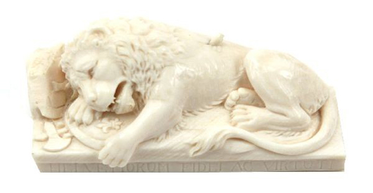 Carved ivory Lion of Lucerne, a miniature copy of monument is outside Lucerne, Switzerland, 3 1/2 inches long x 1 1/2 inches high x 1 1/4 inches deep. Estimate: $400-$800. Image courtesy of Affiliated Auctions.