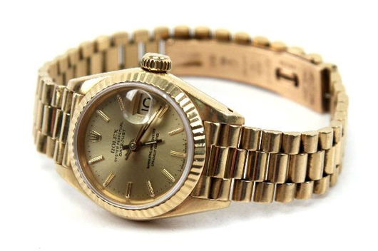Woman's 18kt gold Rolex Oyster Perpetual Datejust, fluted 18K gold bezel, 18k yellow gold face, dial, hands. Estimate: $5,000-$6,000. Image courtesy of Affiliated Auctions.