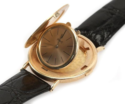Men's 1972 Piaget dress wrist watch, 22kt 1894 $20 gold coin housing with 18k gold flip-out watch, signed 'Piaget' and 'Swiss' on face, caiman band with 18k gold buckle. Estimate: $5,000-$6,000. Image courtesy of Affiliated Auctions.