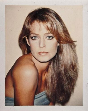 Farrah Fawcett is pictured in a Polaroid color print by Andy Warhol. Image courtesy of LiveAuctioneers Archive and Bloomsbury Auctions.