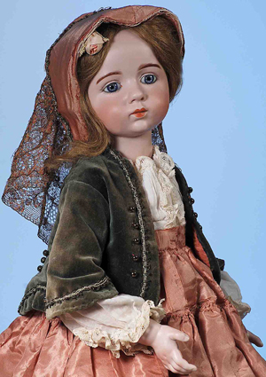 Top lot of the sale, French circa-1914 bisque doll created by sculptor Albert Marque, 22 inches, signed and incised with the number '12,' $168,000. Image by Frasher's Doll Auctions.
