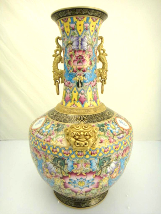 A rare antique Chinese Famille Rose enameled porcelain vase Lot 385 has a four-character Yongzheng mark and is possibly of the period. The interior is designed with dragon faces on the shoulder. It carries an estimate of about $10,000. Image courtesy of 888 Auctions.