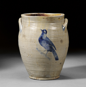 William Capron stoneware jar with incised cobalt flower and bird decoration, Albany, N.Y., circa 1800-05, the front and back decorated with incised cobalt blue decoration, one side depicting a flower blossom, the other a bird, 13 3/8 inches high. Estimate $2,000-$3,000. Image courtesy of Skinner Inc.