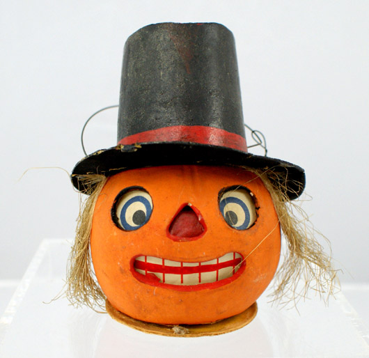 Halloween candy container jack-o-lantern with top hat. Image courtesy of William H. Bunch.