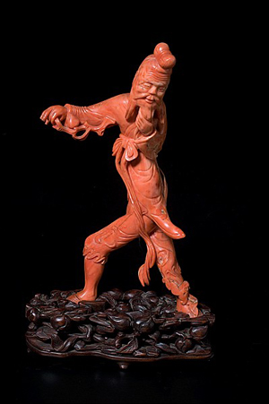 Chinese coral figure of a man. Estimate: $10,000-$12,000. Estimate: $10,000-$12,000. Image courtesy of Cowan's Auctions.