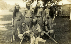 1928 photo of one of the greatest House of David baseball teams, with their canine mascot who traveled with them. Front, left to right: Mud Williams, Horrace Hannaford, George Anderson. Back: Dave Harrison, Percy Walker, Tom Dewhirst and Bob Dewhirst. Percy Walker signed a baseball bat along with Babe Ruth that year stating he was the only one who had ever struck out Ruth twice in one game. Image courtesy of House of David Museum.
