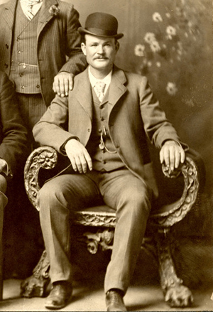 Butch Cassidy poses in a photo of the 'Wild Bunch' gang, Fort Worth, Texas, circa 1900-1901.